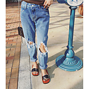 女性の高層マイクロ弾性ジーンズのズボン、緩やかなソリッドブルーの穴