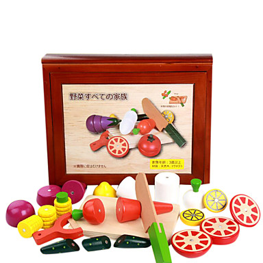 en stor trekasse av frukt og grønnsaker oppriktig, tre barnas lekehus, magnetiske leker